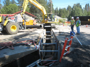 Trenching along city streets for utility relocation efforts